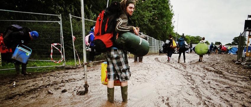 backpacker standing in mud